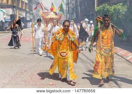 PHANG-NGA (TA-KUA-PA) THAILAND - SEPTEMBER 29: An unidentified people parade celebrate in Phang-Nga Vegetarian Festival on September 29 2014 around the street of Phang-Nga province Thailand.