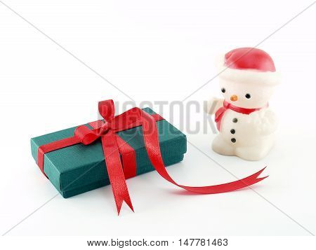 green gift box with red ribbon and snowman lamp isolated on white background