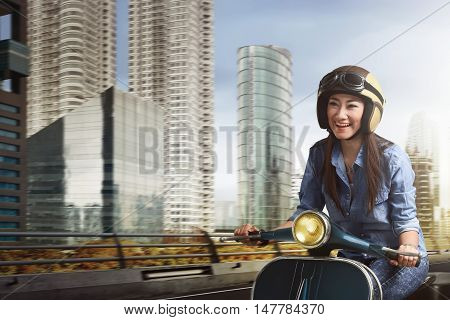 Young Beautiful Asian Woman Riding Scooter Amid The City