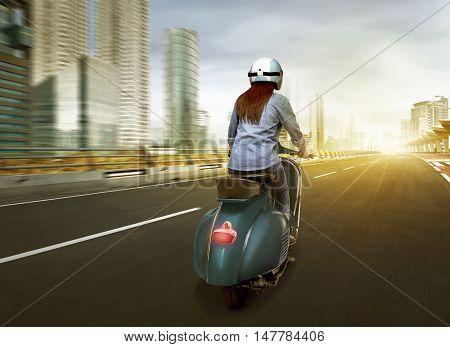 Beautiful Young Asian Enjoying Riding Scooter