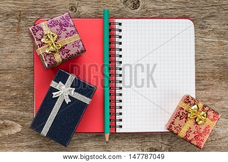 Personal organizer and gift boxes on the wooden background