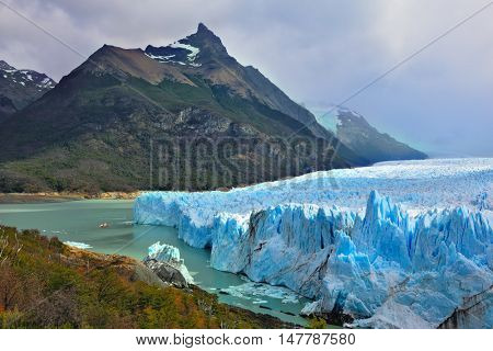 Colossal Perito Moreno glacier in Lake Argentino. Los Glaciares National Park in Argentina. Sunny summer day in February