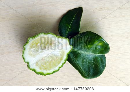 Bergamot Fruit With Leaf On Wooden Board