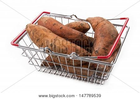 sweet potatoes in a metal shopping basket isolated on white background