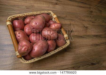 Raw potato. Fresh potatoes on wooden background. Free place for text.