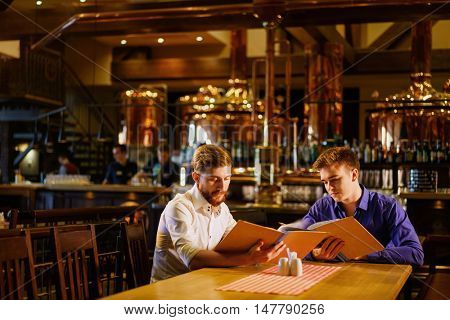 Young men in a bar