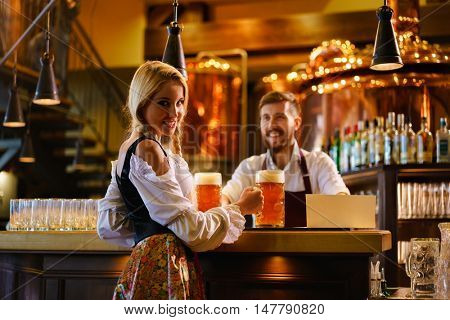 Young waitress and bartender in bar