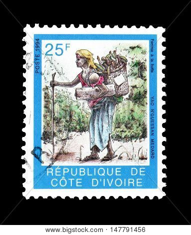 IVORY COAST - CIRCA 1994 : Cancelled postage stamp printed by Ivory Coast, that shows Country woman with basket.