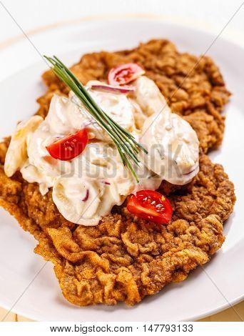 Big wiener schnitzel with potatoes salad, european food