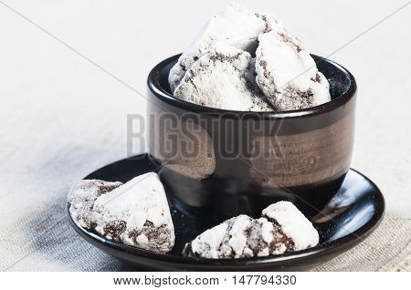 crinkles or chocolate soft cookies with powdered sugar