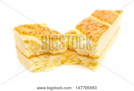 sections of sweet sponge cake on a white background