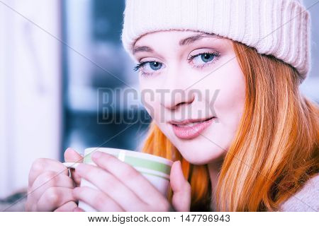 Woman Wearing Warm Clothing And Drinking Hot Drink