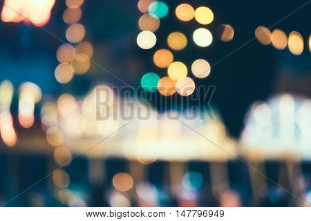 Blur image background of amusement park at night, bokeh background.