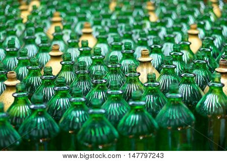 Large group of green recycled glass wine bottles used in Amusement park game corner.
