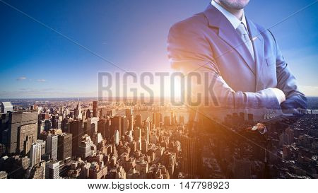 Double exposure of a businessman in front of New York City. Flare effect