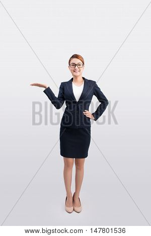 Asian business woman show something isolated on white background asian beauty
