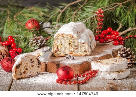 Stollen.Traditional German Christmas cake on a rustic festive table.