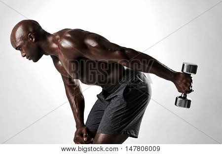 Muscular Man Shirtless Exercising With Heavy Weights