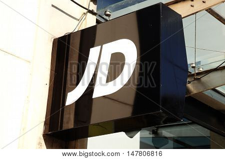 Cardiff, Wales, UK , September 14, 2016 : JD Sports logo advertising sign outside its retail store in Queen Street