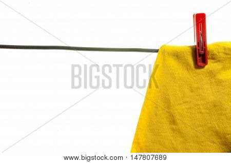 Clothes drying on a rope, isolated on white background