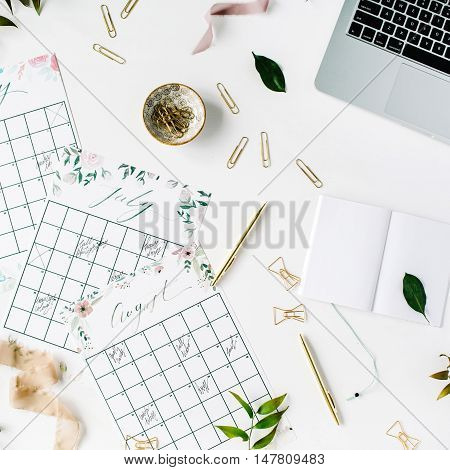 wedding planner schedule calendar painted with watercolor laptop notebook and accessories. flat lay workspace top view