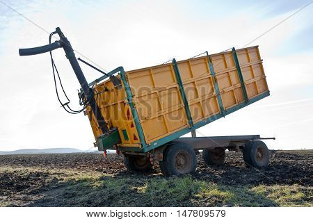 Yellow trailer in an agricultural landscape in Ciudad Real Province, Spain