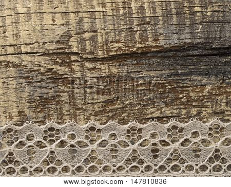 delicate lace on the rustic wooden background