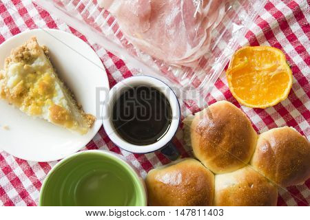morning breakfast at home with tart espresso coffee and roll breads. Top view