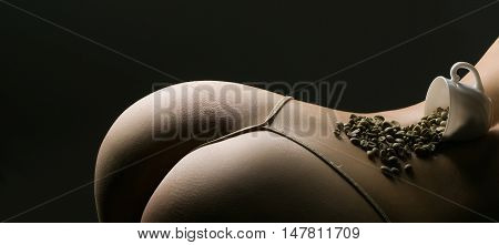 Sexy Female Buttocks With Coffee Beans And Cup
