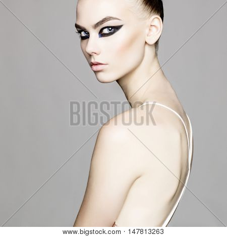 black and white studio photo of elegant lady with smoky-eyes makeup.