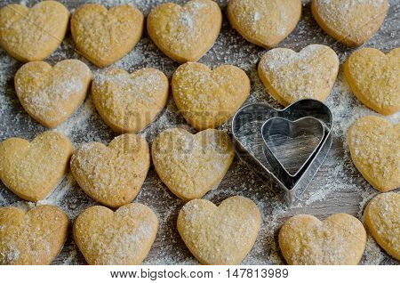 Heart-shaped cookies powdered with sugar for romantic treat