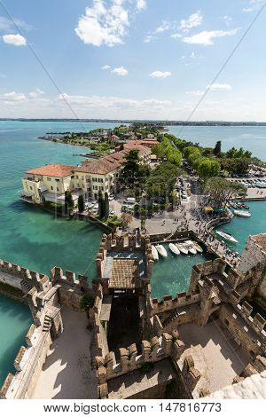 SIRMIONE ITALY - MAY 5, 2016: View of colorful old buildings in Sirmione and Lake Garda from Scaliger castle wall Italy
