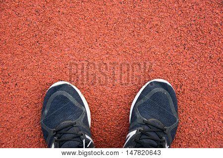 Close Up Running Shoes On Running Track At Sport Stadium