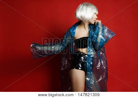 The Photo In Landscape Orientation. Beautiful Girl In A White Wig, Black Underwear And A Raincoat In