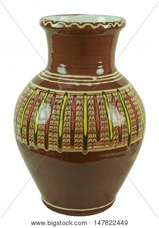 Colorful decorative jug decorated with abstract ornament - handmade pottery clay glazed. Isolated on a white background. Isolated on a white background