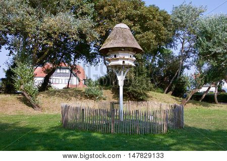 Dovecote in De Haan Belgium in a park in front of a historic building