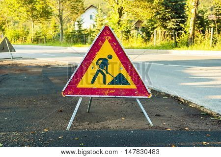 Works ahead warning sign on a road.