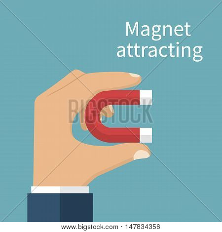 Man Holding Magnet In Hand