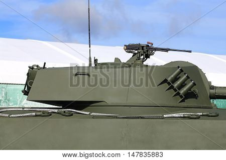 Rotating tower of the self-propelled gun consisting service of Russian army with 122 mm self-propelled howitzer 127 millimeter machine gun and grenade system