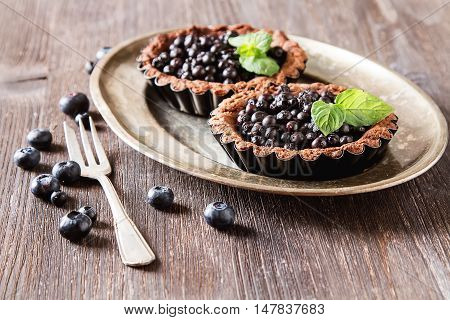 Homemade Chocolate Blueberry Pie With Mint Leaves On A Dark Wood