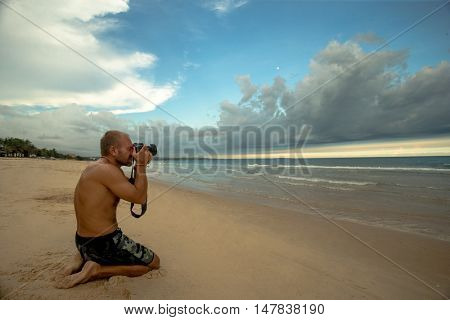Professional photographer on the beach