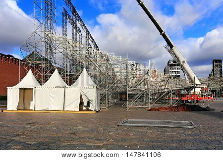 White tents on the camp of the scenery construction on the Red Square in Moscow in preparation for the festival