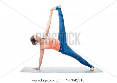 Beautiful sporty fit woman practices yoga asana Vasisthasana B - side plank pose with lifted leg isolated on white background