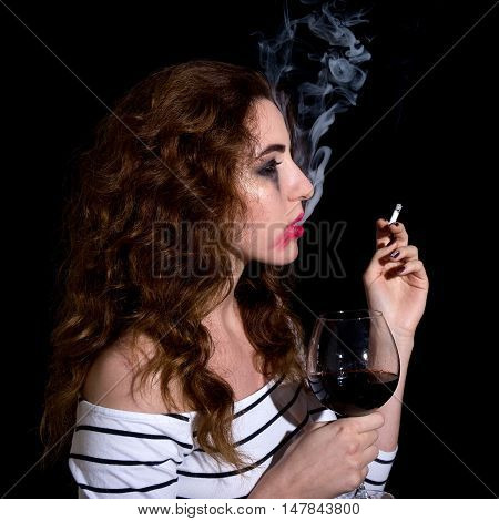 Depression And Addiction Concept - Crying Sad Woman Drinking Wine And Smoking Isolated On Black
