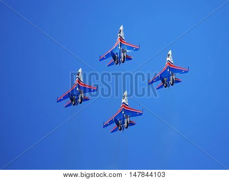 MOSCOW REGION - AUGUST 30: Demonstrative performance of the aerobatic team of Russian military aircrafts