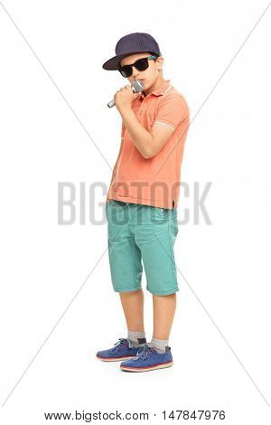 Young rapper posing with a microphone isolated on white background