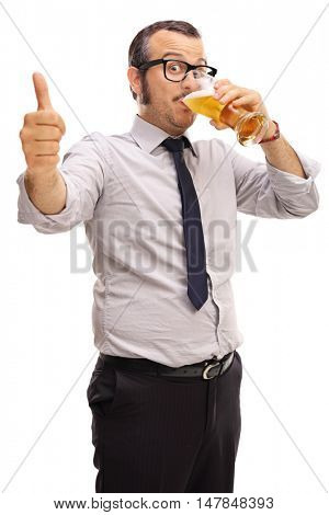 Young businessman drinking beer and giving a thumb up isolated on white background