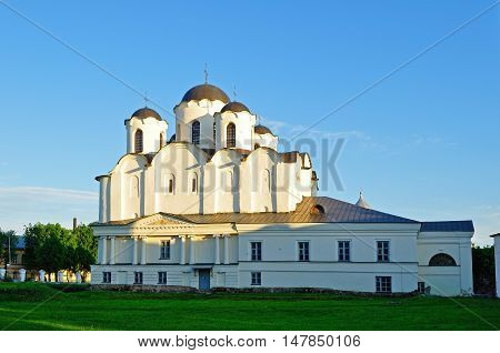 Sunset colorful view of St Nicholas Cathedral at Yaroslav Courtyard Veliky Novgorod Russia. Architecture landscape of cathedral in sunny evening in Veliky Novgorod Russia