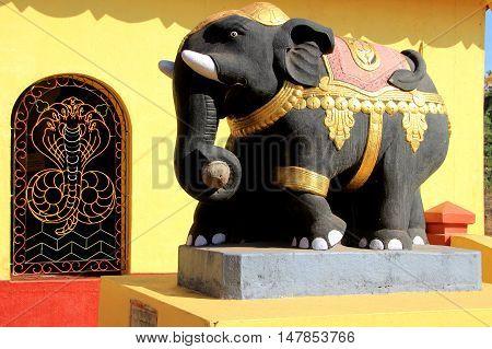 Bright painted cement elephant at Kudupu Shri Ananthapadmanabhaswami Temple Mangalore Karnataka India Asia