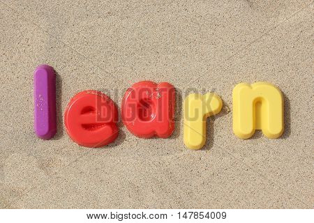 A playful image spelling out the word 'learn' with toy plastic letters. Learning is fun.